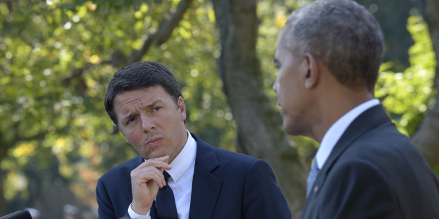 Italian Prime Minister Matteo Renzi listens as President Barack Obama speaks during their joint news conference in the Rose Garden of the White House in Washington, Tuesday, Oct. 18, 2016. (AP Photo/Susan Walsh)