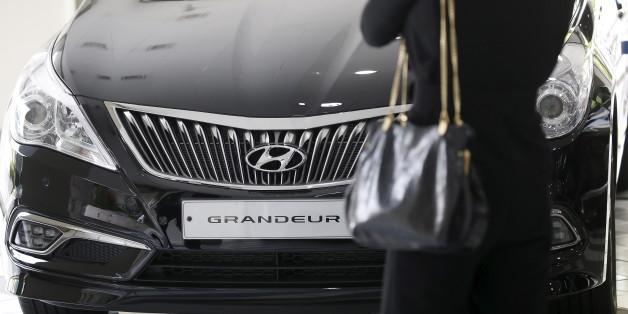 A visitor looks at a Hyundai Motor's Grandeur sedan at its dealership in Seoul, South Korea, April 25, 2016. REUTERS/Kim Hong-Ji
