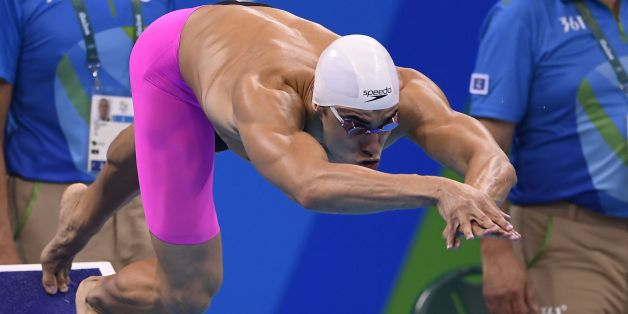 Algeria's Oussama Sahnoune competes in a Men's 100m Freestyle heat during the swimming event at the Rio 2016 Olympic Games at the Olympic Aquatics Stadium in Rio de Janeiro on August 9, 2016.   / AFP / GABRIEL BOUYS        (Photo credit should read GABRIEL BOUYS/AFP/Getty Images)