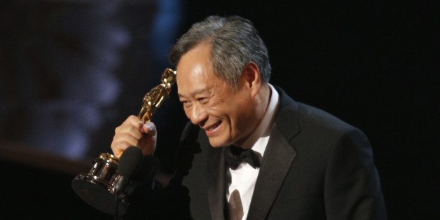 """Director Ang Lee reacts after winning the Oscar for best director for """"Life of Pi"""" at the 85th Academy Awards in Hollywood, California, February 24, 2013.      REUTERS/Mario Anzuoni (UNITED STATES  - Tags: ENTERTAINMENT)  (OSCARS-SHOW)"""
