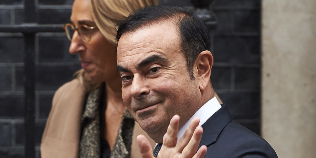 Nissan CEO Carlos Ghosn (R) waves as he leaves No 10 Downing Street in central London on October 14, 2016, after meeting with British Prime Minister Theresa May.Earlier this month, Ghosn said that Nissan was delaying new investment at its giant plant in Sunderland, northeast England, announcing: 'We cannot stay if the conditions do not justify that we stay.' / AFP / NIKLAS HALLE'N        (Photo credit should read NIKLAS HALLE'N/AFP/Getty Images)