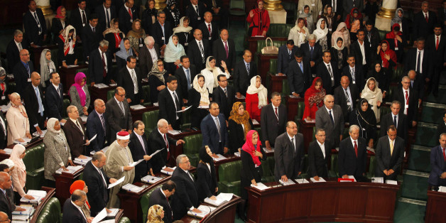 Members of the Tunisian parliament take oath in Tunis December 2, 2014. Tunisia's first full elected parliament held its opening session on Tuesday with a challenge to implement the democracy its people sought when they marched in the 2011 revolt against autocrat Zine el-Abidine Ben Ali. REUTERS/Zoubeir Souissi (TUNISIA - Tags: ELECTIONS POLITICS)
