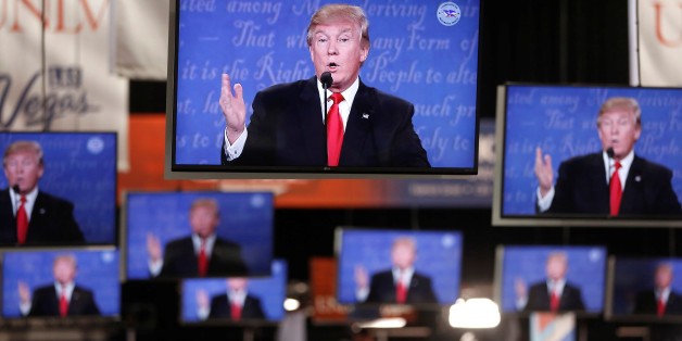Republican U.S  presidential nominee Donald Trump is shown on TV monitors in the media filing room on the campus of University of Nevada, Las Vegas, during the last 2016 U.S. presidential debate in Las Vegas, U.S., October 19, 2016. REUTERS/Jim Urquhart