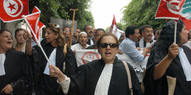 Tunis, TUNISIA:  Tunisian Lawyers shout during a protest against the Israeli offensive in Lebanon 09 August 2006 in Tunis. Tunisian President Ben Ali strongly denounced the Israeli attacks in Lebanon where at least 1,087 people, mostly civilians, have been killed since 12 July, according to an AFP count of official tolls today.   AFP PHOTO/FETHI BELAID  (Photo credit should read FETHI BELAID/AFP/Getty Images)