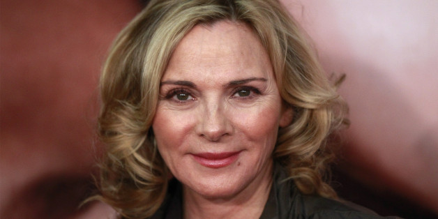 """Actress Kim Cattrall arrives for the premiere of the film """"The Five-Year Engagement"""" to begin the 2012 Tribeca Film Festival in New York, April 18, 2012. The premiere of the film starring Jason Segel and Blunt, by the same team behind """"Forgetting Sarah Marshall,"""" kicked off the festival which is entering its second decade with organizers promising a broader quality of films from all regions of the world. REUTERS/Lucas Jackson (UNITED STATES - Tags: ENTERTAINMENT)"""