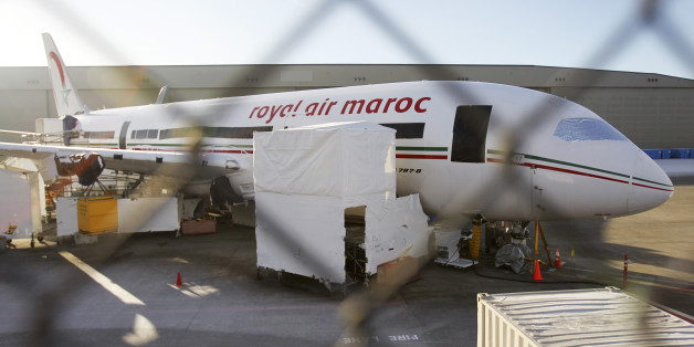 A 787 Dreamliner jet painted in Royal Air Maroc livery, sits idle on the tarmac parking at Paine Field in Everett, Washington, January 17, 2013. Airlines scrambled to rearrange flights as Europe, Japan, Qatar and India joined the United States in grounding Boeing Co's 787 Dreamliner passenger jets while battery-related problems are investigated. REUTERS/Anthony Bolante (UNITED STATES - Tags: TRANSPORT BUSINESS)