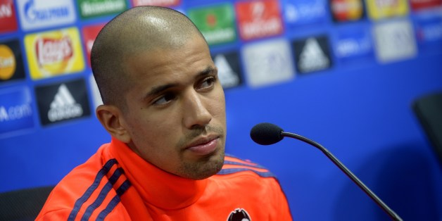 Valencia's French midfielder Sofiane Feghouli looks on during a press conference at the Valencia's Sport City in Valencia on October 19, 2015, on the eve of the UEFA Champions League group H match Valencia CF vs KAA Gent.   AFP PHOTO/ JOSE JORDAN        (Photo credit should read JOSE JORDAN/AFP/Getty Images)