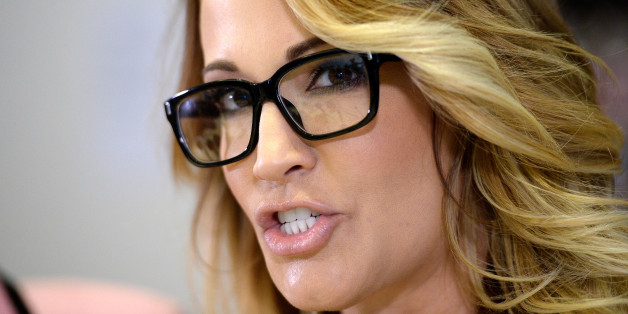 Jessica Drake speaks to reporters about allegations of sexual misconduct against Donald Trump, alongside lawyer Gloria Allred (L) during a news conference in Los Angeles, California, U.S. October 22, 2016.  REUTERS/Kevork Djansezian