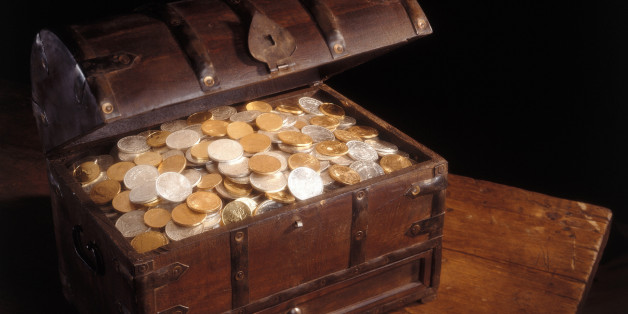 Wooden chest full of silver and gold coins.