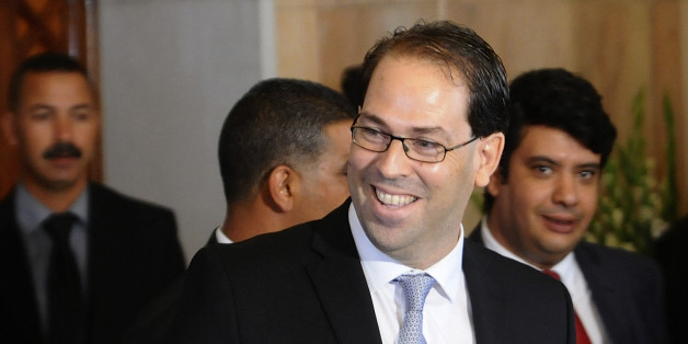 Tunisia's new Prime Minister Youssef Chahed smiles before a press conference at the presidential palace in Tunis, Wednesday, Aug.3, 2016. Chahed served as minister for local affairs in the government that fell over the weekend in a no-confidence vote. The choice of Chahed is controversial in some minds because he is related by marriage to President Beji Caid Essebsi, who nominates the new prime minister. (AP Photo/Hassene Dridi)