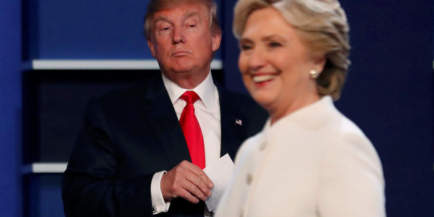 Republican U.S. presidential nominee Donald Trump and Democratic U.S. presidential nominee Hillary Clinton finish their third and final 2016 presidential campaign debate at UNLV in Las Vegas, Nevada, U.S., October 19, 2016.      REUTERS/Mike Blake       TPX IMAGES OF THE DAY