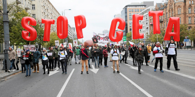 People march to protest against the planned CETA free trade agreement (Comprehensive Economic and Trade Agreement) between the European Union and Canada, and similar plans between EU and United States (TTIP) in Warsaw, Poland October 15, 2016. Agencja Gazeta/Kuba Atys/via REUTERS ATTENTION EDITORS - THIS IMAGE WAS PROVIDED BY A THIRD PARTY. EDITORIAL USE ONLY. POLAND OUT.