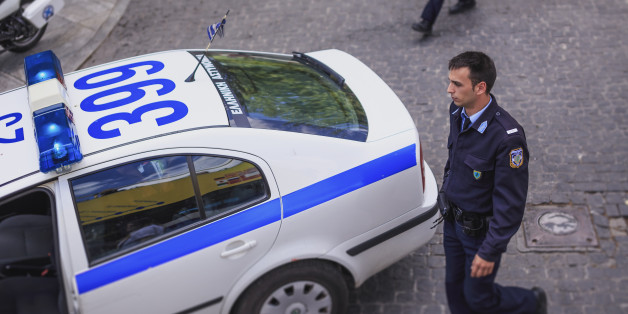 Elevated view of Greek policeman and car