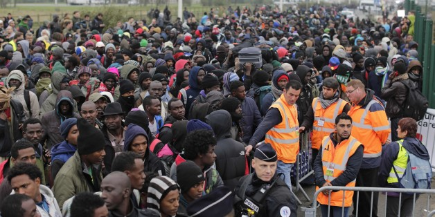 """Migrants line-up to register at a processing centre in the makeshift migrant camp known as """"the jungle"""" near Calais, northern France, Monday Oct. 24, 2016. French authorities are beginning a complex operation, unprecedented in Europe, to shut down the makeshift camp, uprooting thousands who made treacherous journeys to escape wars, dictators or grinding poverty and dreamed of making a life in Britain. (AP Photo/Emilio Morenatti)"""