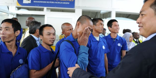 Hostage of Somali pirates react as they arrive at the Jomo Kenyatta International Airport in Nairobi on October 23, 2016 after being freed with other hostages. Somali pirates have freed 26 Asian hostages held for nearly five years after the hijacking of their fishing vessel, the last commercial ship seized at the height of the country's piracy scourge, negotiators said on October 22, 2016. The crew of the Naham 3, the second longest held hostage by Somali pirates, were taken captive when their Omani-flagged vessel was seized in March 2012 south of the Seychelles.  / AFP / STRINGER        (Photo credit should read STRINGER/AFP/Getty Images)