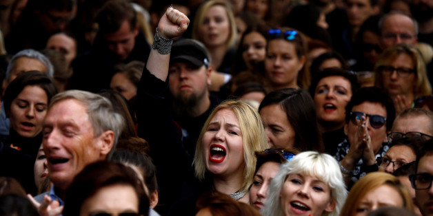 "A woman shouts slogans as she takes part in an abortion rights campaigners' demonstration ""Black Protest"" in front of the Parliament in Warsaw, Poland October 1, 2016. REUTERS/Kacper Pempel/File Photo"