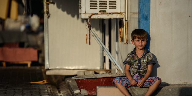 A Syrian child sits at a refugee camp in the Kilis district of Gaziantep, southeastern Turkey, on October 23, 2016. France's foreign minister urged the international community to 'do everything' to end the 'massacre' in the Syrian city of Aleppo after fighting resumed following a 72-hour truce declared by Damascus ally Russia. / AFP / OZAN KOSE        (Photo credit should read OZAN KOSE/AFP/Getty Images)