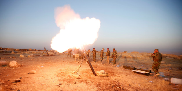Peshmerga forces fires a mortar towards Islamic state militants' positions in the town of Naweran near Mosul, October 23, 2016. REUTERS/Azad Lashkari