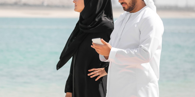 Arab couple with traditional wear on the beach