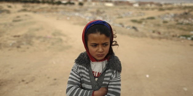 Shahda, 8, stands at the impoverished Zhor neighborhood of Kasserine, where young people have been demonstrating for jobs since last week, January 28, 2016. REUTERS/Zohra Bensemra