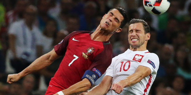 MARSEILLE, FRANCE - JUNE 30, 2016: Portugal's Cristiano Ronaldo (7) and Grzegorz Krychowiak (10) jump to head the ball in their 2016 UEFA European Football Championship quaterfinal match at Stade Velodrome. Alexander Demianchuk/TASS (Photo by Alexander Demianchuk\TASS via Getty Images)