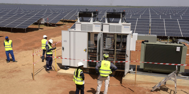 Technicians operate electrical cabinets on October 22, 2016 during the opening ceremony of a new photovoltaic energy production site in Bokhol. Senegal put into service one of sub-Saharan Africa's largest solar energy projects Saturday as it pushes to become a regional player in renewables on a continent where the majority remain off-grid. / AFP / SEYLLOU        (Photo credit should read SEYLLOU/AFP/Getty Images)