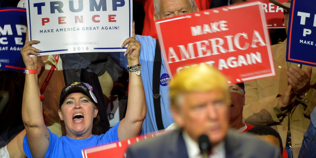 Supporters cheer as Republican Presidential nominee Donald Trump speaks during a campaign rally for Republican Presidential Donald Trump in Cincinnati, Ohio, U.S., October 13, 2016. REUTERS/Bryan Woolston