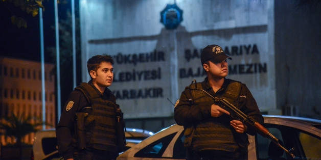 Armed Turkish anti riot police officers stand in front of the Diyarbakir's municipality headquarters on October 25, 2016 in Diyarbakir. 