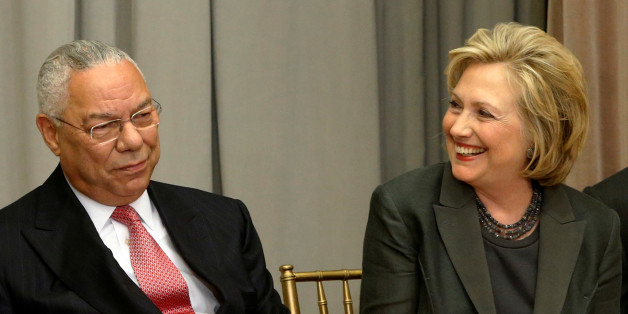 Former U.S. Secretaries of State Colin Powell (L) and Hillary Clinton listen to remarks at a groundbreaking ceremony for the U.S. Diplomacy Center in Washington September 3, 2014.  REUTERS/Jonathan Ernst/File Photo