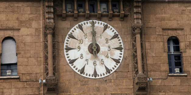 A clock above the entrance to Rabat's post office strikes noon March 30, 2012. REUTERS/Youssef Boudlal (MOROCCO - Tags: SOCIETY BUSINESS)
