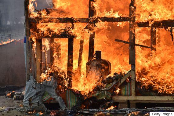 calais migrant camp fire