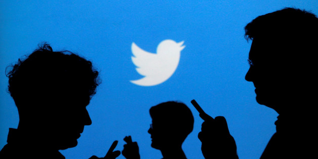 """People holding mobile phones are silhouetted against a backdrop projected with the Twitter logo in this illustration picture taken in  Warsaw September 27, 2013.   REUTERS/Kacper Pempel/Illustration/File Photo     GLOBAL BUSINESS WEEK AHEAD PACKAGE - SEARCH """"BUSINESS WEEK AHEAD JULY 25"""" FOR ALL IMAGES"""