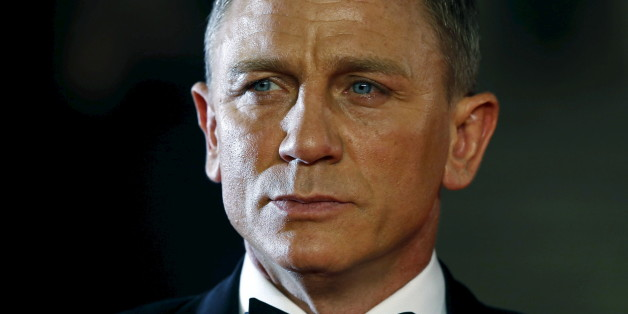 "Daniel Craig poses for photographers as he attends the world premiere of the new James Bond 007 film ""Spectre"" at the Royal Albert Hall in London, Britain, October 26, 2015. REUTERS/Luke MacGregor/Files"