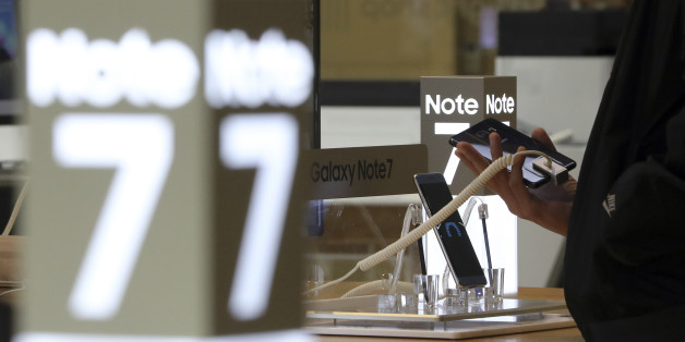 In this Tuesday, Oct. 11, 2016 photo, a visitor tries out a Samsung Electronics Galaxy Note 7 smartphone at its shop in Seoul, South Korea. South Korea's third-quarter economic growth has slipped to its lowest level in more than a year, with Samsung's Galaxy Note 7 recall having an impact. (AP Photo/Lee Jin-man)