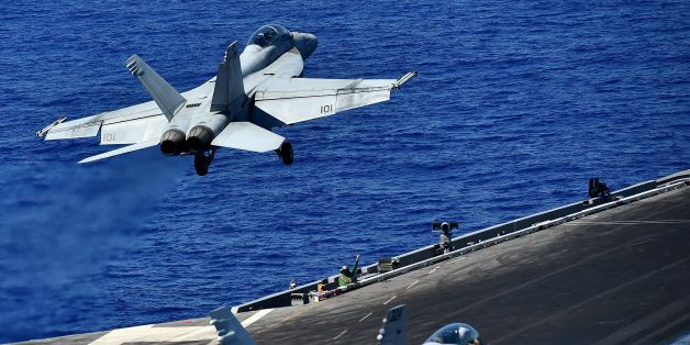 An F/A-18F Super Hornet takes off from the US navy's super carrier USS Dwight D. Eisenhower (CVN-69) ('Ike') in the Mediterranean Sea on July 7, 2016. The US aircraft carrier is deployed in support of Operation Inherent Resolve, maritime security operations and theater security cooperation efforts in the US 6th Fleet area of operations. Air Wings embarked aboard conducted strikes against the terrorist group ISIL in Libya, Iraq and Syria.  / AFP / ALBERTO PIZZOLI        (Photo credit should read