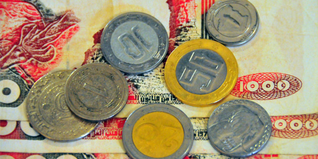Algerian 1000 dinar bank notes and coins - currency of Algeria, DZD - photo by M.Torres