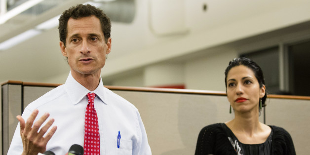 FILE - In this July 23, 2013 file photo, then-New York mayoral candidate Anthony Weiner speaks during a news conference alongside his wife Huma Abedin in New York. The FBI informed Congress on Friday, Oct. 28, 2016, it is investigating whether there is classified information in new emails that have emerged in its probe of Hillary Clinton's private server. A U.S. official told The Associated Press the newly discovered emails emerged through the FBI's separate sexting probe of former congress