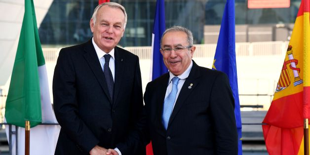 French Foreign Minister Jean-Marc Ayrault (L) shakes hands with his Algerian counterpart Ramtane Lamamra (R) upon his arrival at the Villa Mediterranée in Marseille, southern France, on October 28, 2016, for the 13th meeting of the Foreign Affairs Ministers of the Western Mediterranean (5+5 Dialogue). / AFP / ANNE-CHRISTINE POUJOULAT        (Photo credit should read ANNE-CHRISTINE POUJOULAT/AFP/Getty Images)