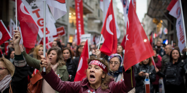 ISTANBUL, TURKEY - OCTOBER 29:  People wave flags and shout slogans during a rally marking the 93rd Anniversary of Turkey's Republic day on October 29, 2016 in Istanbul, Turkey. Republic Day is a commemoration of the proclamation of the Republic of Turkey, which was first officially declared in 1923 by founder and first president Mustafa Kemal Ataturk.  (Photo by Chris McGrath/Getty Images)