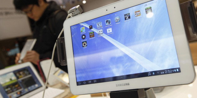 Samsung Electronics' Galaxy tablet computers are displayed at a store in Seoul January 24, 2013. Samsung Electronics Co turned cautious on spending for the first time since the global financial crisis, keeping its annual investment plan unchanged at 2012 levels, as demand for computer chips wanes and the smartphone market slows. Samsung had poured money into factories to boost production of chips and panels used in Apple products and its Galaxy range devices, pushing its operating profit to 8.84