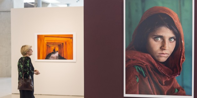 ANKARA, TURKEY - SEPTEMBER 15: Photographs taken by American photographer Steve McCurry, best known for his photo 'Afghan Girl', are displayed at CerModern in Ankara, Turkey on September 15, 2015. The exhibition will last from 16 September to 13 December 2015. (Photo by Mustafa Kamaci/Anadolu Agency/Getty Images)