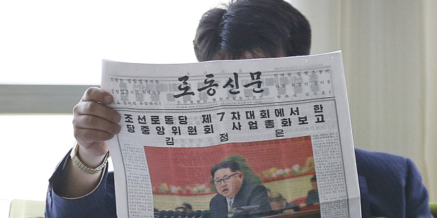 A North Korean man reads a local newspaper with an image of leader Kim Jong Un Sunday, May 8, 2016, in Pyongyang, North Korea. North Korean leader Kim Jong Un said during a critical ruling party congress that his country will not use its nuclear weapons first unless its sovereignty is invaded, state media reported. (AP Photo/Kim Kwang Hyon)