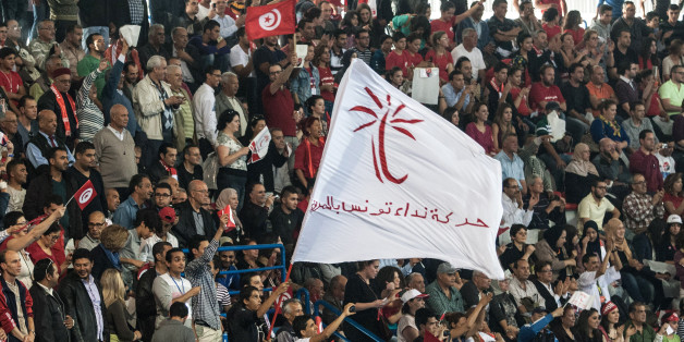 In this photo taken Saturday, Nov. 15, 2014, thousands of supporters of the Nidaa Tounes party led by Beji Caid Essebsi attend an electoral meeting in Tunis, Tunisia. The presidential campaign, featuring 25 competitors, kicked off in early November and it's the first time since Tunisians overthrew dictator Zine El Abidine Ben Ali in 2011 that they will choose their head of state through universal suffrage. If no candidate wins a majority Nov. 23, there will be a runoff between the top two vote-getters on Dec. 28. (AP Photo/Aimen Zine)