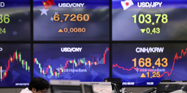 A currency trader watches monitors at the foreign exchange dealing room in Seoul, South Korea, Thursday, Oct. 13, 2016. Asian stocks were lower on Thursday as weak China export data disappointed investors and renewed concerns about the health of the world's second-largest economy. (AP Photo/Lee Jin-man)