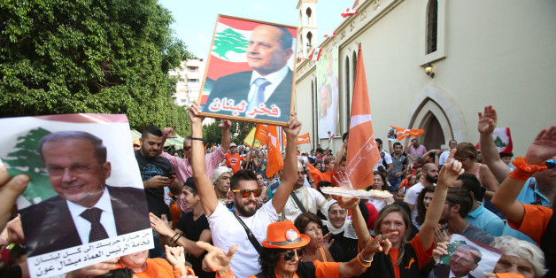 People carry pictures of newly appointed Lebanese President Michel Aoun while waving Free Patriotic Movement (FPM) flags in the Haret Hreik area, southern suburbs of Beirut, Lebanon October 31, 2016. REUTERS/Khalil Hassan