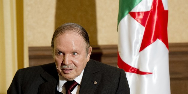 Algerian President Abdelaziz Bouteflika meets with his French counterpart Francois Hollande at the Zeralda private residence on June 15, 2015, in Algiers. Hollande is on a friendship and working visit to Algeria at the invitation of Algerian President, Abdelaziz Bouteflika as the two nations, once bitter foes, work ever closer to tackle regional threats from Mali to Libya. AFP PHOTO / POOL / ALAIN JOCARD        (Photo credit should read ALAIN JOCARD/AFP/Getty Images)