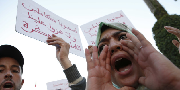 """A Moroccan shouts as thousands of Moroccans protest against the death of Mouhcine Fikri last Friday,  with placard reading """"mash us of respect us"""", in the northern city of Hoceima in Rabat, Morocco, Sunday, Oct. 30, 2016.  Crowds of Moroccans are protesting, seemingly incensed by the death of a fisherman crushed to death in a garbage truck. (AP Photo/Abdeljalil Bounhar)"""
