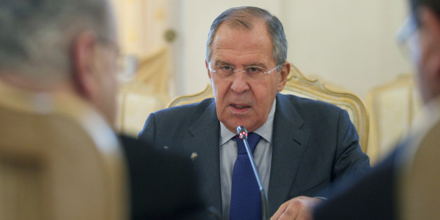 Russian Foreign Minister Sergey Lavrov speaks to his Cyprus' counterpart Ioannis Kasoulides, left, during their meeting in Moscow, Russia, on Monday, Oct. 31, 2016. (AP Photo/Ivan Sekretarev)