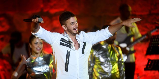 Morocco singer Saad Lamjarred performs during the 52 sesion of the International Carthage Festival on July 30, 2016 at the romain theatre of carthage near Tunis.  / AFP / FETHI BELAID        (Photo credit should read FETHI BELAID/AFP/Getty Images)