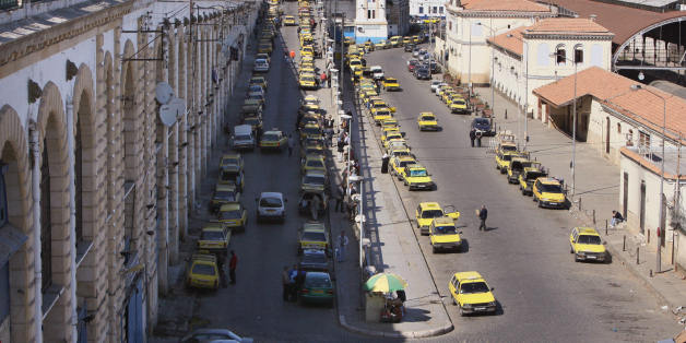 Algiers, ALGERIA:  A picture taken 24 April 2006 shows taxis at a taxi stop near the port of Algiers. Algerians living in France use ships operating between Algiers and Marsielle. AFP PHOTO/FAYEZ NURELDINE  (Photo credit should read FAYEZ NURELDINE/AFP/Getty Images)